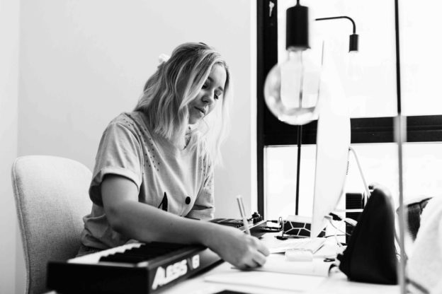 Female startup founder writing