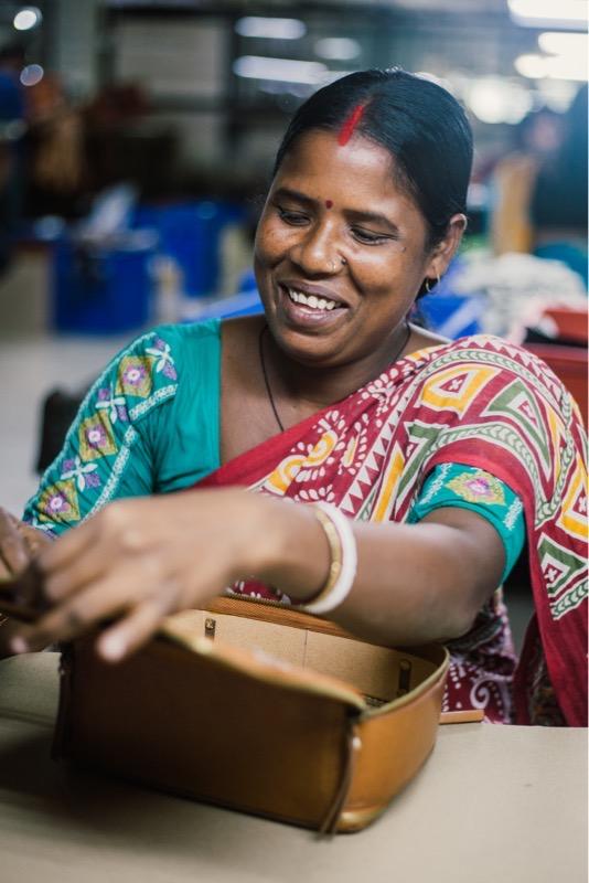 Women in business producing fair trade bags