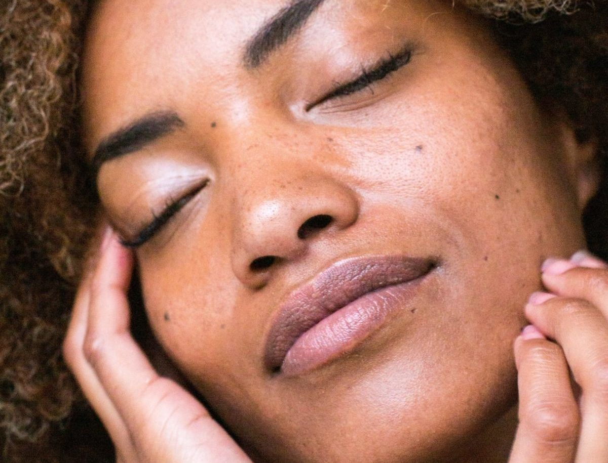 Black woman touching her face